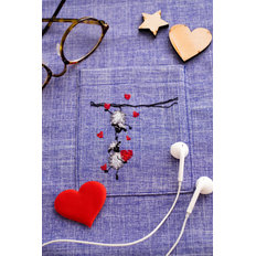 фото: вышивка крестиком на одежде Барашки
