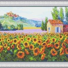 фото: картина для вышивки крестом поле подсолнухов, домик, гора